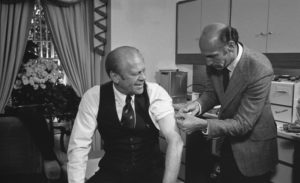 President Gerald Ford gets a swine flu vaccination from White House physician, Dr. William Lukash, in 1976. Credit: Wikimedia Commons