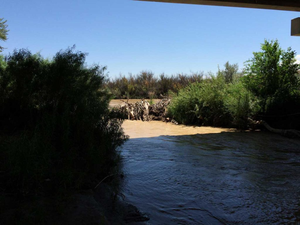 The San Juan River flows under a bridge in Shiprock. MARISA DEMARCO / KUNM