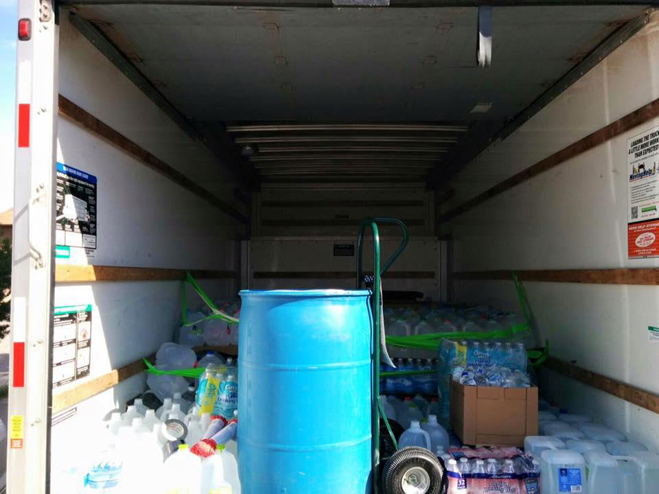 Water donations loaded into the back of a truck destined for Shiprock. ELIZABETH MCKENZIE
