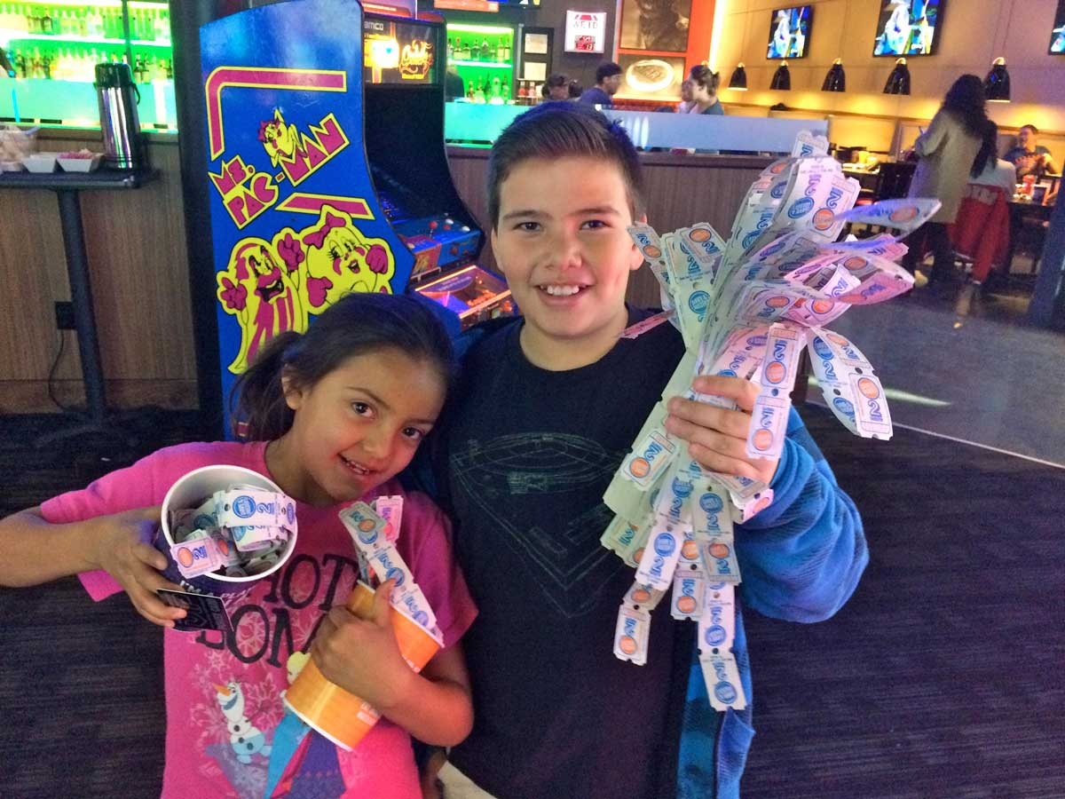 Adonijah and his sister Evelyn at Dave and Buster's MARISA DEMARCO / KUNM