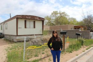 Sonya Maria Martinez stands in the Hopewell Mann area of Santa Fe, where new homes intermingle with old ones. Credit Ed Williams