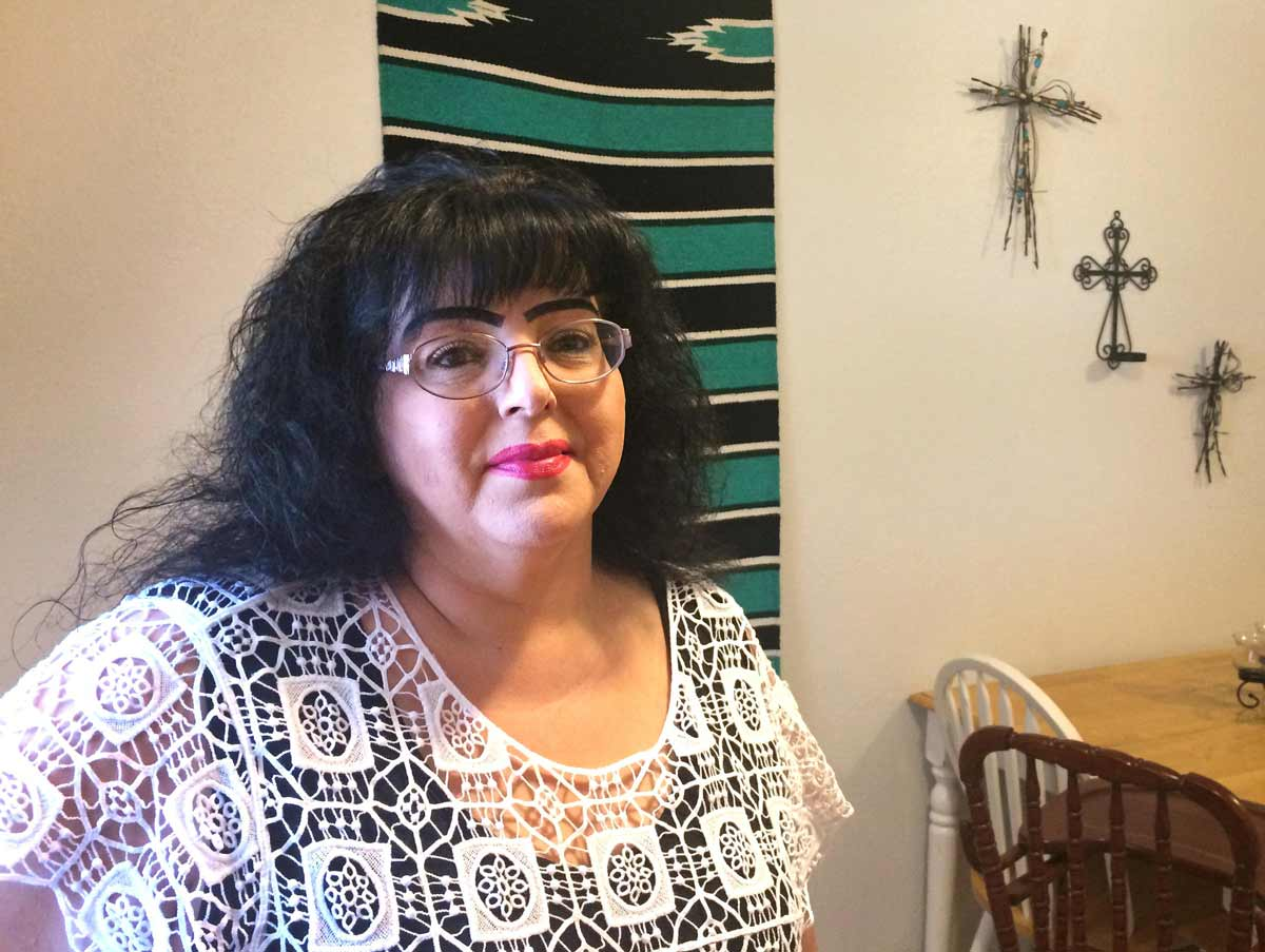 Angela Dominguez works for the Income Support Division in Portales, N.M. She's a whistleblower who spoke out about the practice of changing food stamps applications. Marisa DeMarco / KUNM
