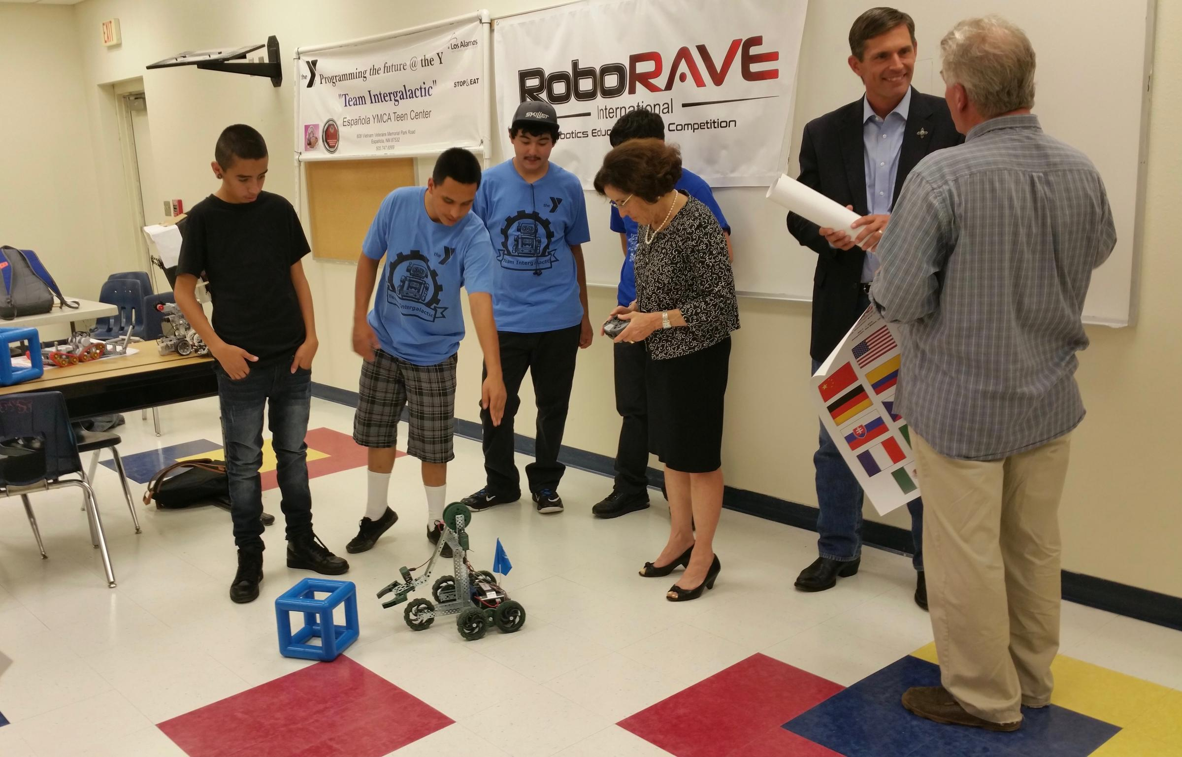 National Science Foundation director France Córdova pilots a robot built by students at the YMCA Teen Center's robotics club Ed Williams / KUNM
