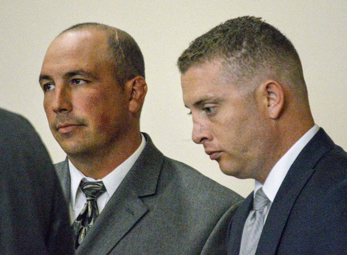 Former Albuquerque Police Detectives Keith Sandy, left, and Officer Dominique Perez speak with attorneys during a preliminary hearing Russell Contreras / Associated Press