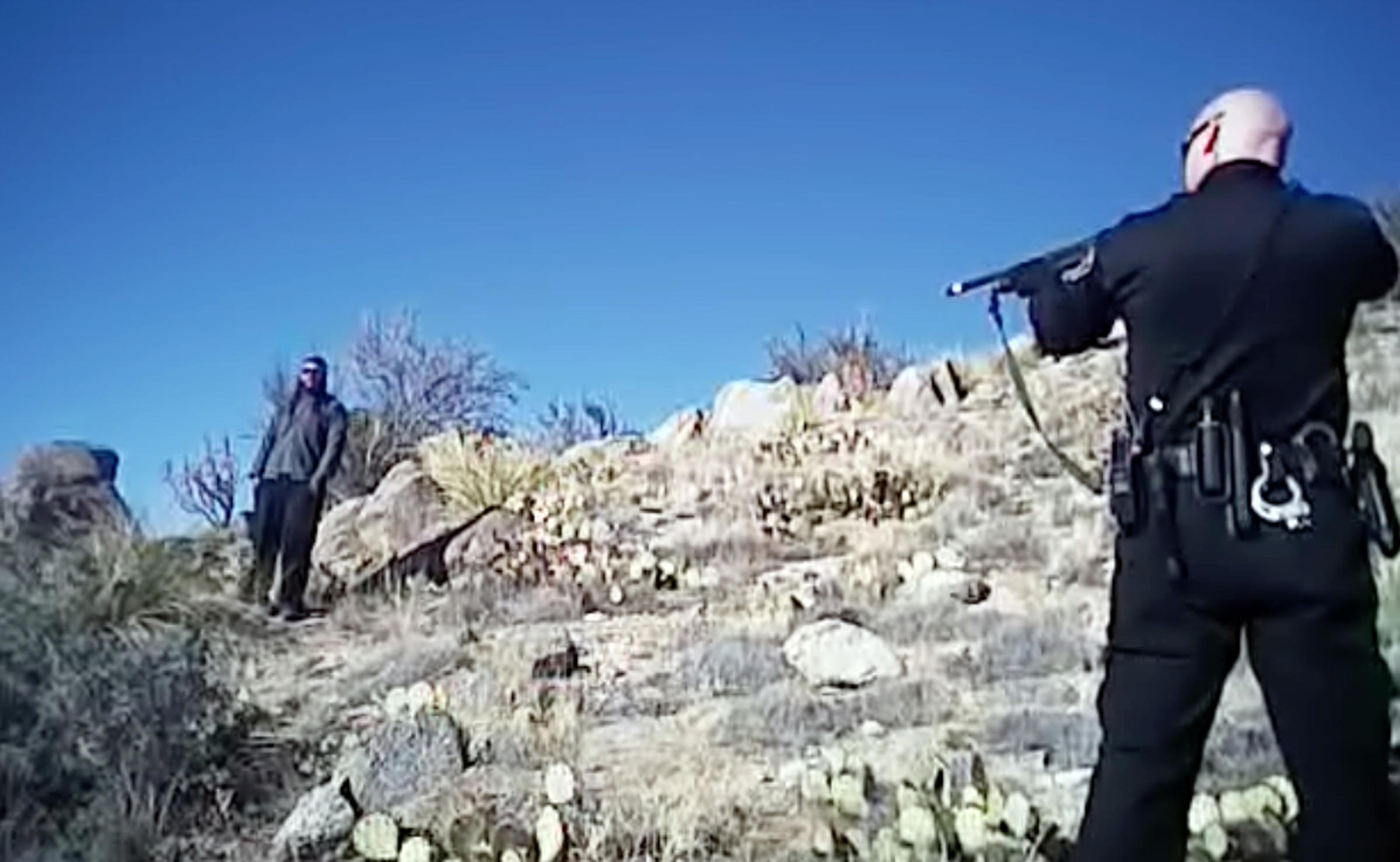 This image made from a March 16, 2014 video shows James Boyd, 38, left, during a standoff with officers in the Sandia foothills in Albuquerque, N.M., before police fatally shot him. Albuquerque Police Department via Associated Press