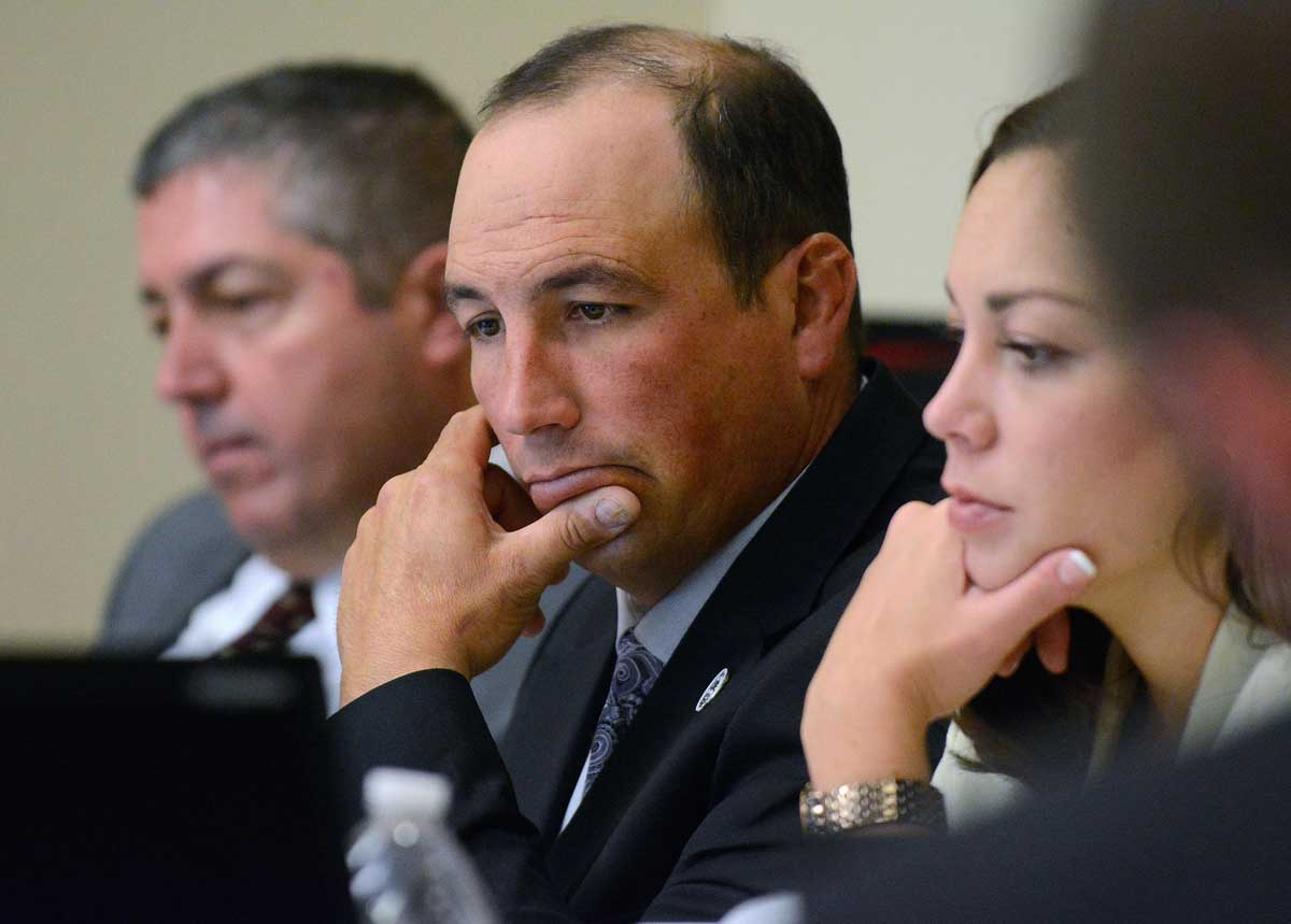 Former APD officer Keith Sandy (center) with his attorneys Sam Bregman and Monnica Garcia Jim Thompson / Albuquerque Journal