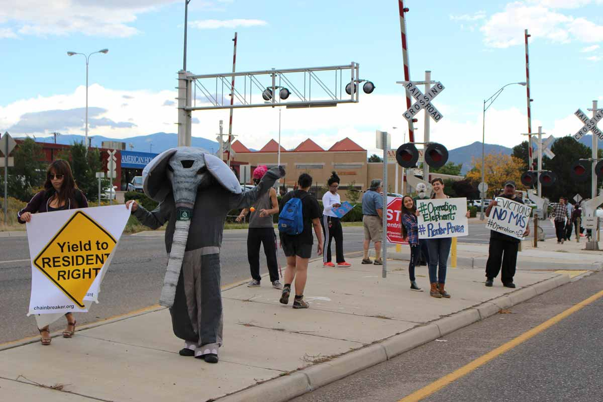 """Affordable housing advocates gathered on St. Michaels Dr. in Santa Fe to demand protections for renters. """"If my rent goes any higher I will probably have to move to Albuquerque,"""" said one protester. Ed Williams/KUNM"""