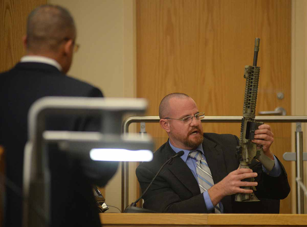 Geoffrey Stone testifies holding the rifle that Dominique Perez used when he shot James Boyd in 2014. The defense successfully argued that the gun should not be introduced as evidence in the trial. Adolphe Pierre-Louis/Albuquerque Journal