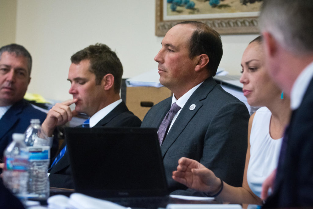 Former APD officer Keith Sandy, third from left, waits with attorneys before closing arguments. Marla Brose / Albuquerque Journal